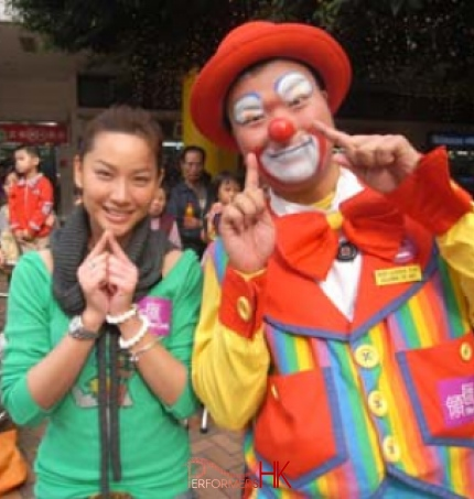 Roving clown taking picture with with TVB artist Tsui Zi San at a Hong Kong corporate function