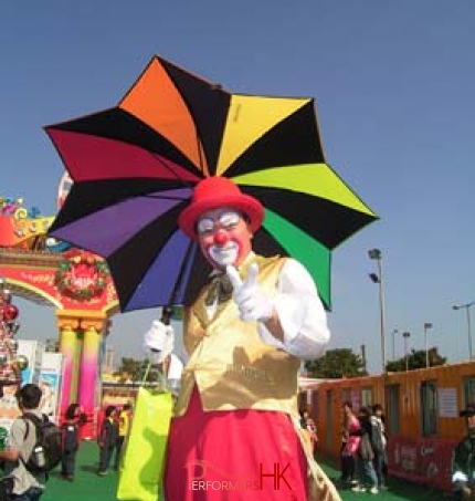 Tony with his rainbow umbrella at a carnival in Hong Kong