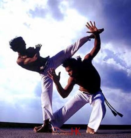 Two male doing Brazilian martial arts