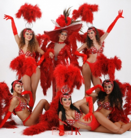 6 vegas dancers pose for camera studio shot
