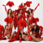 Vegas showgirls costume with bright red feathers and extravagant head gear.