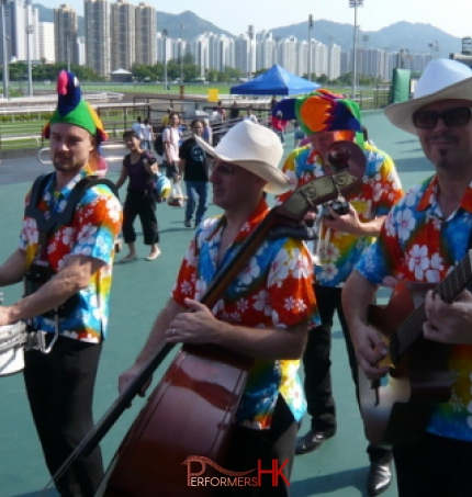 Four roving magicians playing drums guitar cello entertaining crowds at the Hong Kong racecourse