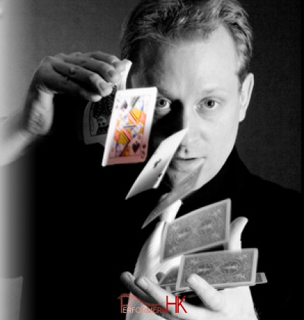 Magician ruffling cards