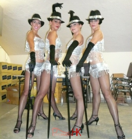 4 dancers in silver costume posing