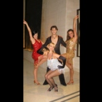 Three gorgeous dancers in sparkling costumes with a male dancer.