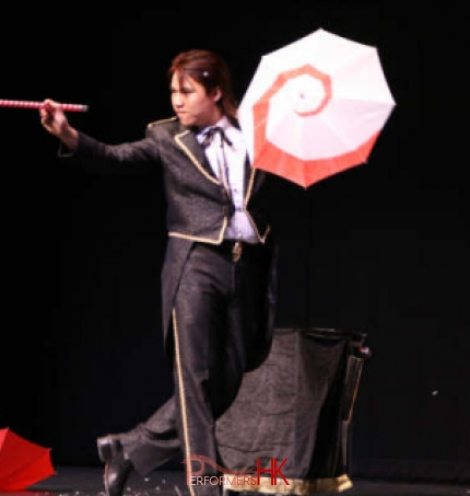 Hong Kong magician performing stage illusion magic with umbrella and wand at corporate annual dinner