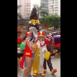 Dressed up as clowns, performers entertain guests with their magic tricks.