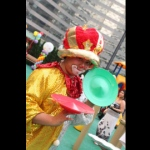 Roving juggling clown in Hong Kong posting with two juggling plates at a corporate family day