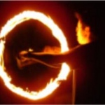 Professional fire performer in Hong Kong performing Fire Twirling for a annual dinner