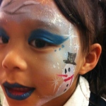 Face painter in Hong Kong paint a Xmas themed face paint for a little girl at Christmas corporate event