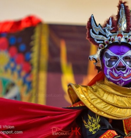 Hong Hong Traditional face changing performer performing at a Corporate event