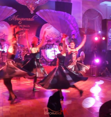 four cancan dancers spinning in circle on dance floor at an event
