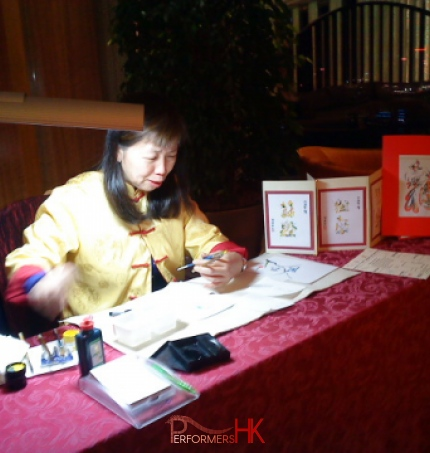 Female artist about to draw a calligraphy print