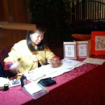 Calligraphy artist drawing momento items at an event at Marriot Hong Kong