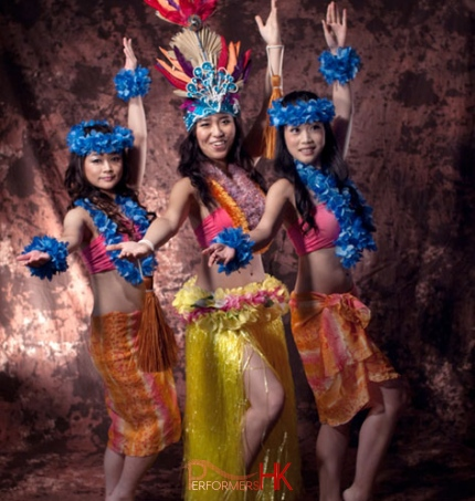 3 island dancers posing in costumes for photoshoot