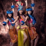 Hula and Tahiti Dancers posing in their tropical costumes.