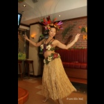 Hula dancer wearing a gorgeous headpiece for her performance.
