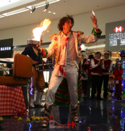 Juggler performing with fire at a Hong Kong shopping mall function