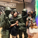Toy soldiers posing with customers at a store event launch in Hysan Place Hong Kong.
