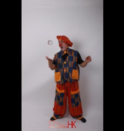 Hong Kong walk around clown juggler posing with his crystal ball