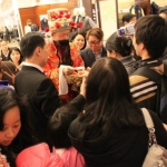 Choi Sun giving out Lai See at Causeway Bay Sogo.