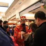 Choi Sun giving out Lai See at Tsim Sha Tsui Sogo.
