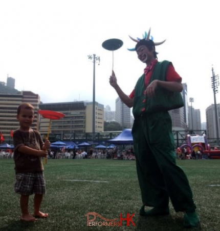 Hong Kong roving clown juggler spinning a circus plate with a guest at a corporate event in HK Football Club