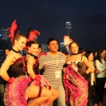 HKTDC event with Can can dancers, guests enjoying the networking event with beautiful dancers and backdrop of Hong Kong.