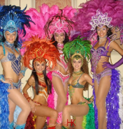 Promotional studio shot of 5 Brazilian dancers in full costume at the disney hotel in Hong Kong