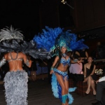 two samba dancers dancing whilst guests look on