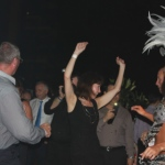 Guests having a good time dancing with Samba dancers at a cocktail party.