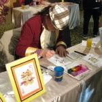 The rainbow calligraphy artist drawing a calligraphy for guest.