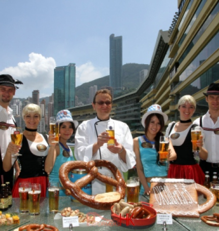 Four dancers in Hong Kong wearing German traditional costume posing for the Hong Kong Jockey Club Oktoberfest event