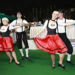 Two pairs of Bavarian dance dancers during their performance at the Jockey Club.