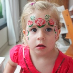 A lovely rose crown face paint.