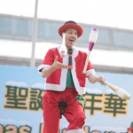 Unicyclist performing three cups juggling on the unicycle at Hong Kong Shopping center corporate Christmas Carnival event