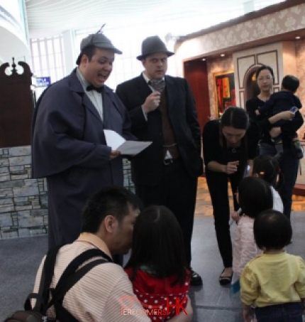 Two Hong Kong professional theater actors running a Easter role play workshop,leading the little detectives to solve the chocolate bunny missing case at the Hong Kong airport