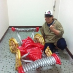 Hong Kong Roving balloons twister with his Red and sliver balloons race car for a corporate event
