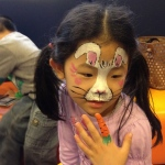 A creative Easter bunny face paint with a carrot finger paint.