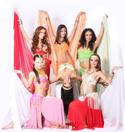 Six Bollywood dancer wearing colorful Bollywood Dance costumes, posing for promote photo for a corporate event in Hong Kong