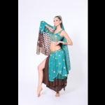 Bollywood dancer posing in teal coloured costume with gold embroidery.
