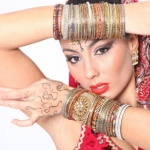 A closer look at the colourful and delicate bangles as well as  bold makeup Bollywood dancers wear.