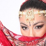 Bollywood Dance costumes feature delicate headpieces and scarves.