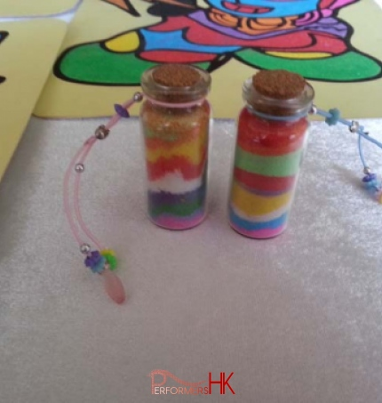Two Sand art bottles by the guest at a Carnival event in Hong Kong