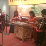 A team of four professional musicians performing Chinese traditional music.