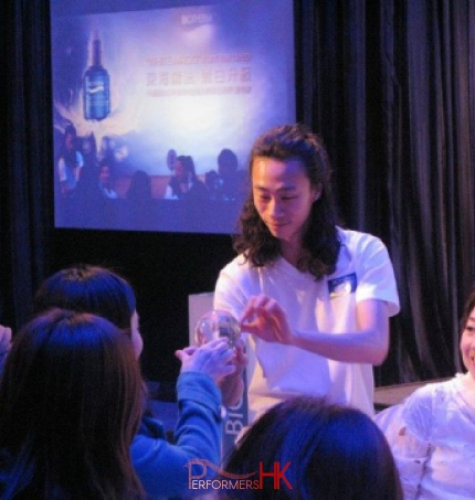 Hong Kong contact juggler performing to a client at a Biotherm product launch event