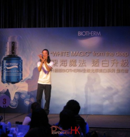 Contact juggler performing a stage show with a crystal ball at Hong Kong Biotherm product launch function