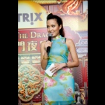 MC Sharika as master of ceremoney in a Chinese traditional Qipao.