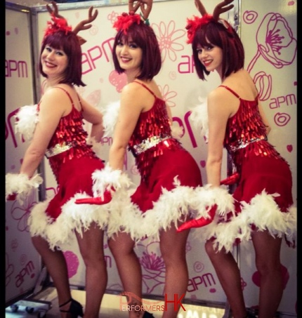 Three reindeer girl dancers in Hong Kong posing at the APM shopping mall Christmas event