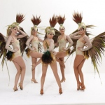 Beautiful and Elegant dancers dressing their feather costumes.